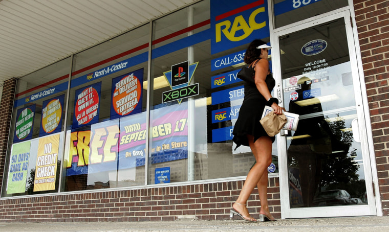 Image: Woman walks into a Rent-a-Center