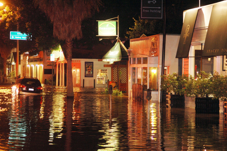 Image: Businesses along Ventura Blvd. in Studio City Calif. are flooded after a water main burst