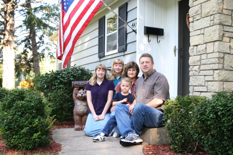 Russell and Kathy Hildebrandtof New Richmond, Wis., successfully paid off $106,000 in credit card and personal debt. They're shown outside their homewith their three children, 14-year-old twins Heidi, left,and Holly, and 3-year-old Joey.