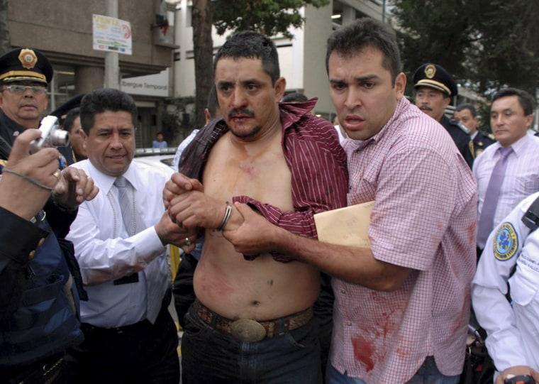 Image: Police arrest a suspected gunman in Mexico City