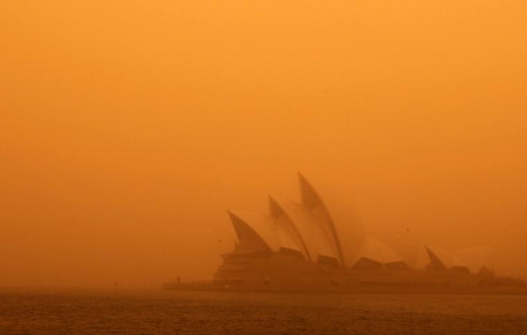 Image: A dust storm blankets Sydney's iconic Opera House at sunrise