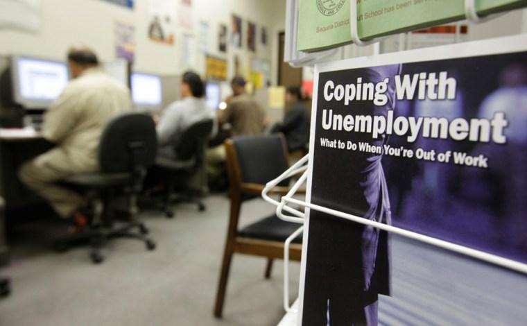Image: People check job listings on computers