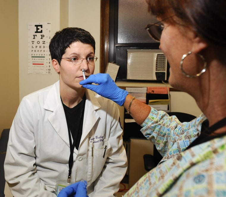 Image: Dr. Tanya Bailey and Marsha Behrens with H1N1 vaccines