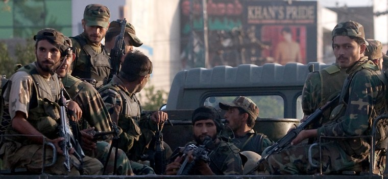 Image: Armed soldiers drive past the front gates of Pakistan's army headquarters in Rawalpindi