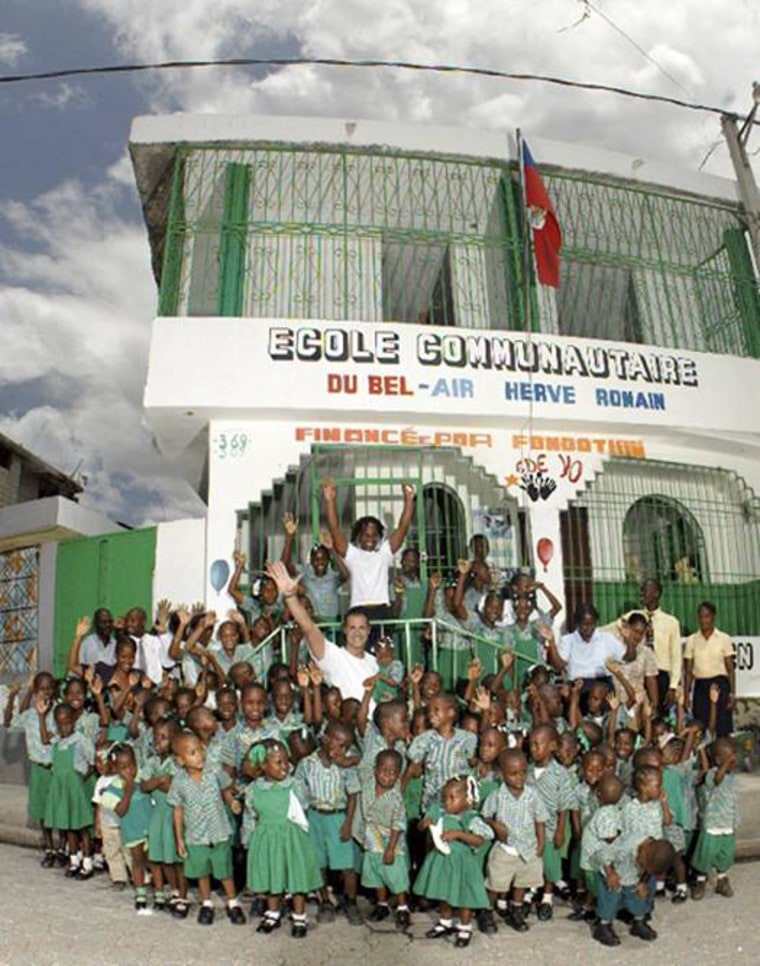 Nigel Barker and Unik Ernest, founder of Edeyo, outside the school in Bel-Air, Port-au-Prince, Haiti.