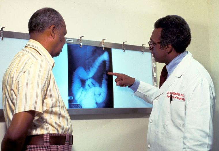 Image: A doctor goes over a patient's x-ray