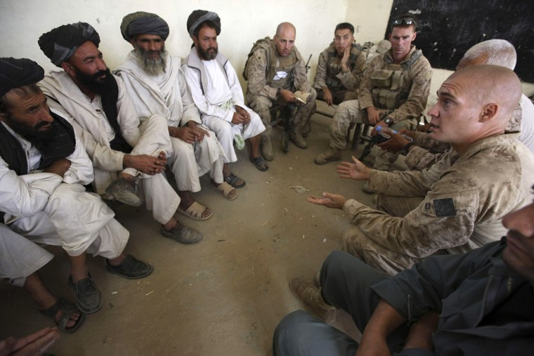 Image: Marines discuss humanitarian projects in Helmand province