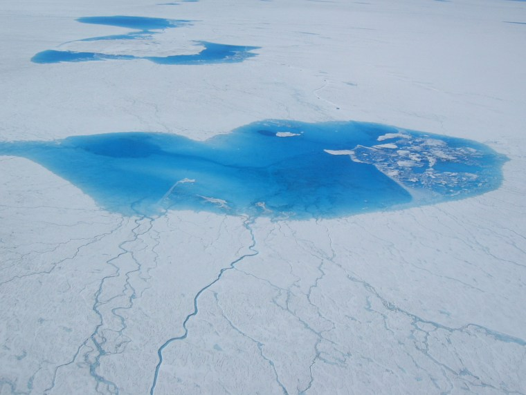 Melt ponds like these form every summer on Greenland, but experts say the rate of melting on the vast ice sheet is speeding up.