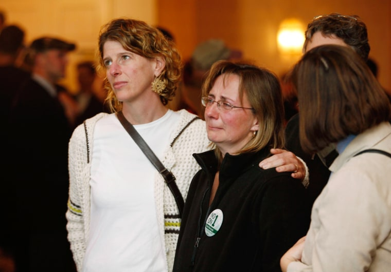 Image: Gay marriage supporters Weiss comforts Hoopes at No on 1/Protect Maine Equality election night rally in Portland