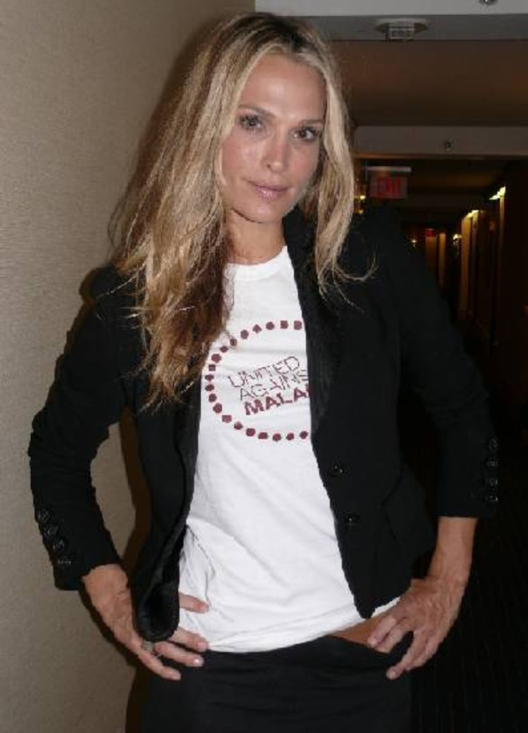 Molly Sims poses with the United Against Malaria T-shirt while attending the Clinton Global Initiative in New York City on Sept. 23.