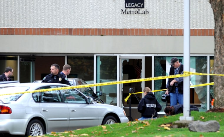 Image: Police comb the scene of a shooting near Portland
