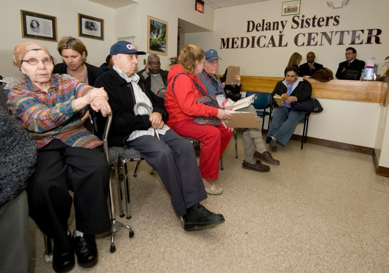 Image:  Patients wait to get their H1N1 flu vaccine