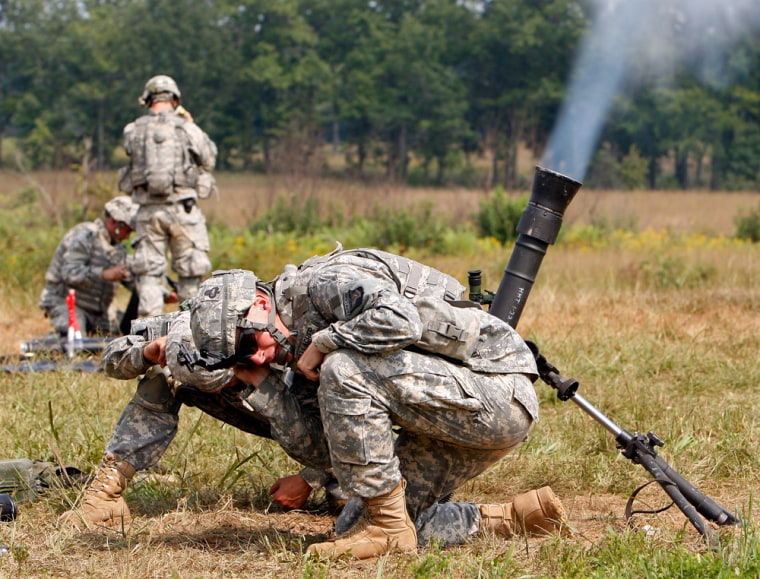 Image: Soldiers fire mortars