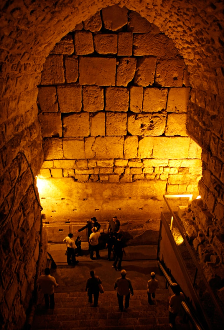 Image: Visitors walk in the tunnels under the Western Wall in Jerusalem