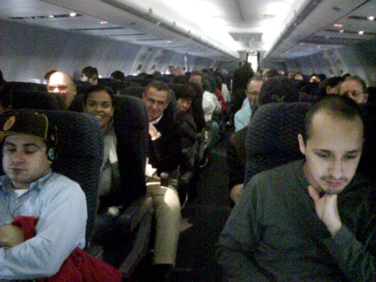 Image: Passengers wait on board a delayed flight from Newark to San Francisco on Thursday morning.