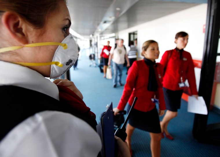 Image: An airline worker wearing a protective mask