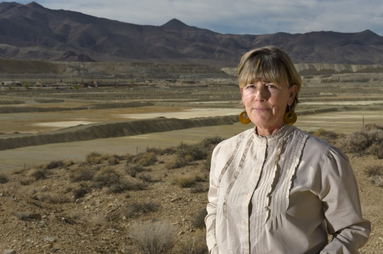 Peggy Pauly, who rallied neighbors around Yerington, Nev.,stands in front of the leach ponds of the former Anaconda copper mine that are tied to groundwater contamination.