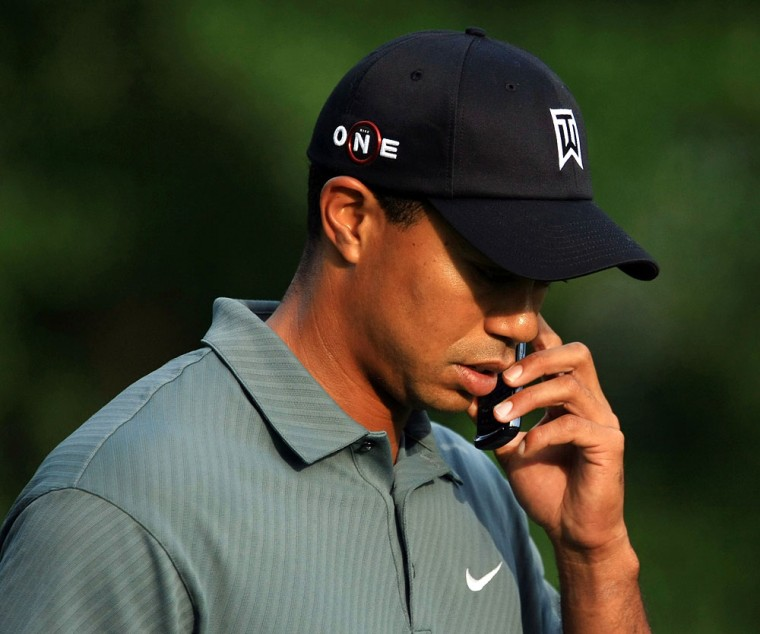 Image: Tiger Woods talks on his cell phone