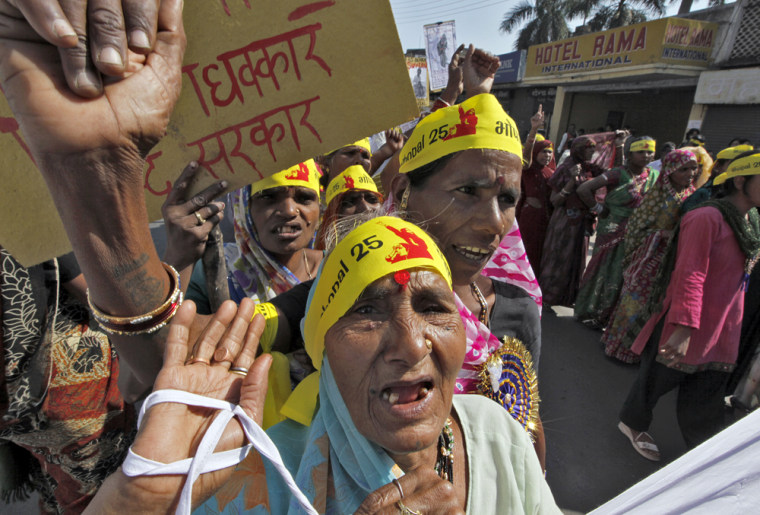 Image: Local activists attend a demonstration to mark the 25th anniversary of the Bhopal gas disaster in Bhopal