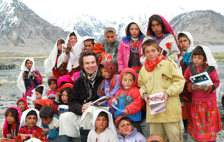 Image: Greg Mortenson with Sarhad village students - Wakhan corridor Pamir mountains NE Afghanistan - one of the most remote places.