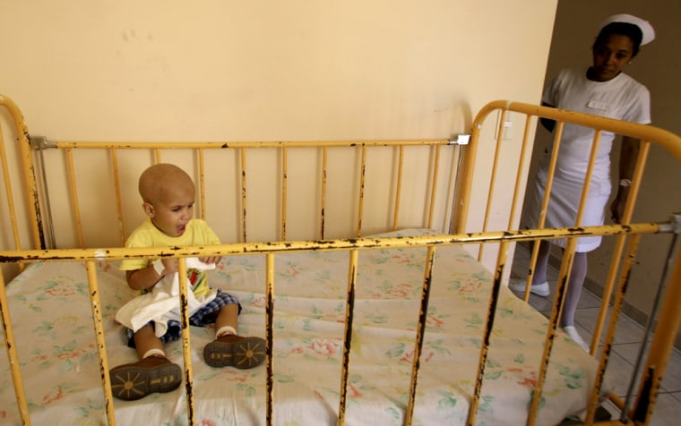 Image: cancer patient Osdiel Montesinos sits in his crib