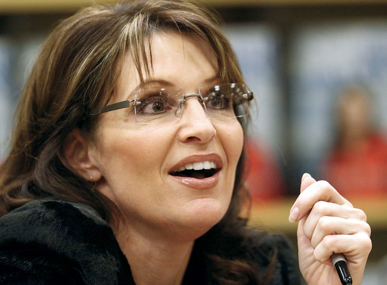 Sarah Palin signs autographs in Sioux City, Iowa, on Sunday.