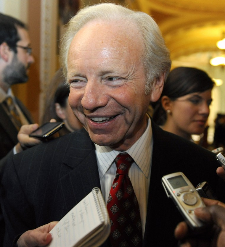 Image: Lieberman talks to reporters about healthcare legislation outside of the senate Democrats' weekly policy lunch at the U.S. Capitol in Washington
