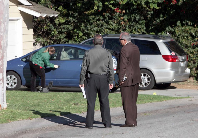 Image: Police investigators stand outside the home of attorney Jeffrey Tidus