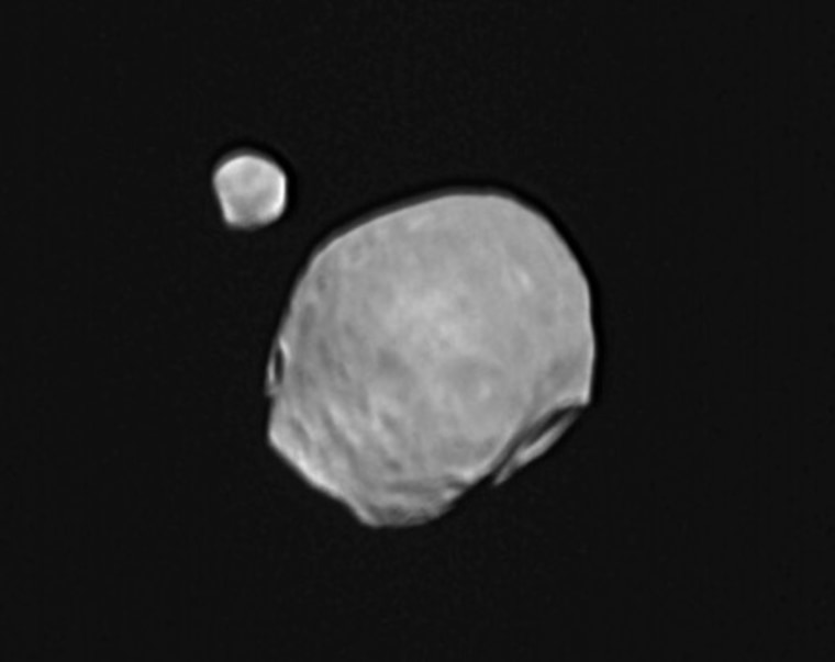 An image from Europe's Mars Express orbiter shows Phobos (the large Martian moon in the foreground) and Deimos (the small moon in the background). When the picture was taken, Phobos was 7,332 miles (11,800 kilometers) away from the spacecraft, and Deimos was 16,280 miles (26,200 kilometers) away.