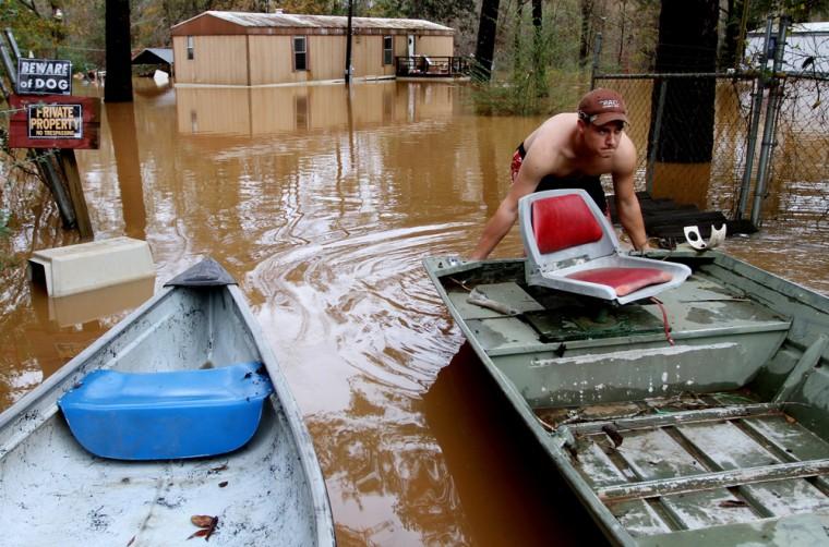 Image: Ricky Catrett loads a boat onto a trailer