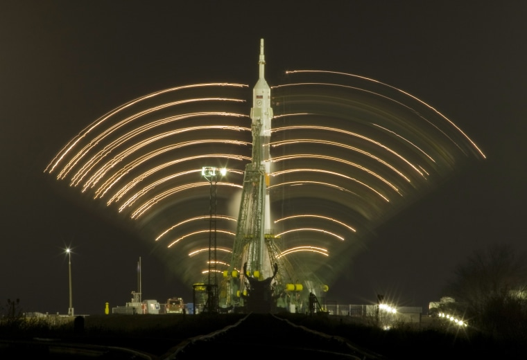 Image: Service towers move away from the Russian Soyuz TMA-17 spacecraft at the Baikonur cosmodrome