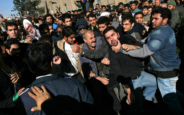 Image: People clash during a funeral for Iranian cleric Montazeri