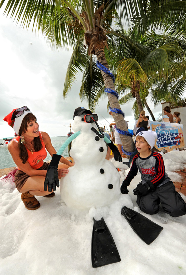 Image: Cyndi Livingston and her grandson play in man-made snow in Florida.