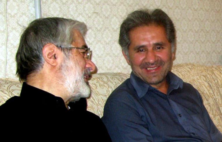Image: Iranian opposition leader Mir Hossein Mousavi, left with his nephew Ali Mousavi