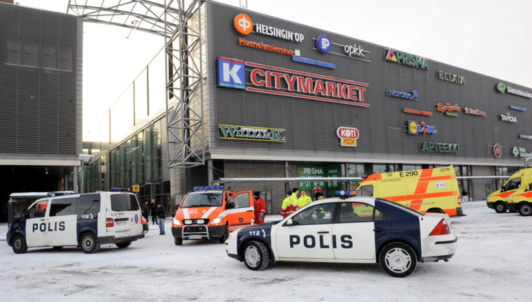 Image: Police vehicles and ambulances are parked outside the Sello shopping centre