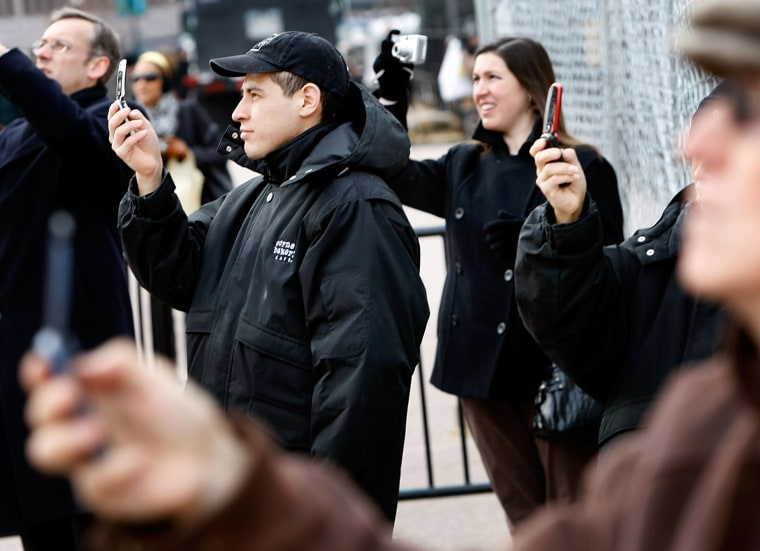 Image: People using cameras and cell phones to photograph