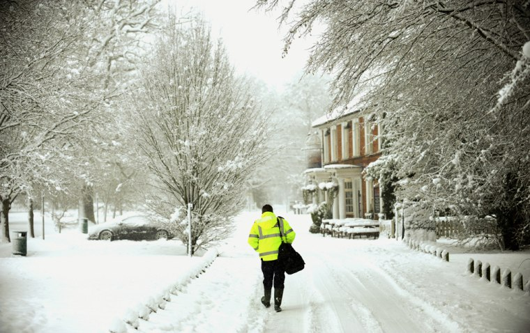 Image: A man walks in the cold in Britain
