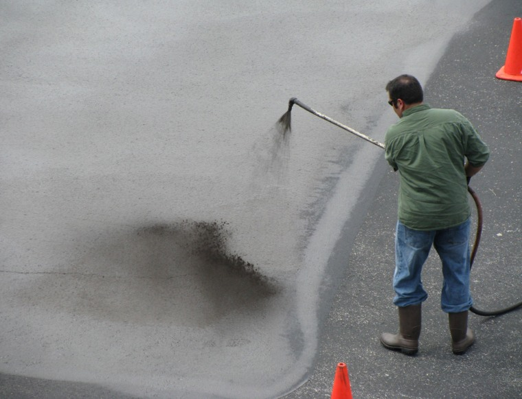 Coal tar sealcoat is applied at a test site at the University of Austin in Texas, where it was studied for a year.