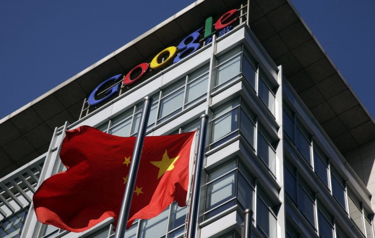 Image: A Chinese flag flutters outside Google's China headquarters in Beijing