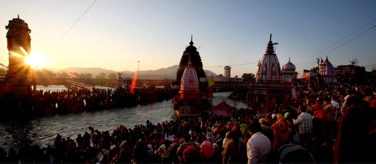 Image: Indian Hindu devotees taking the holy dip in river Ganges