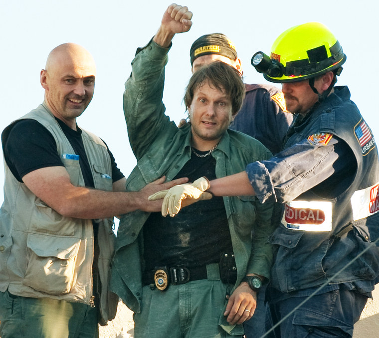 Image: A UN employee celebrates his rescue