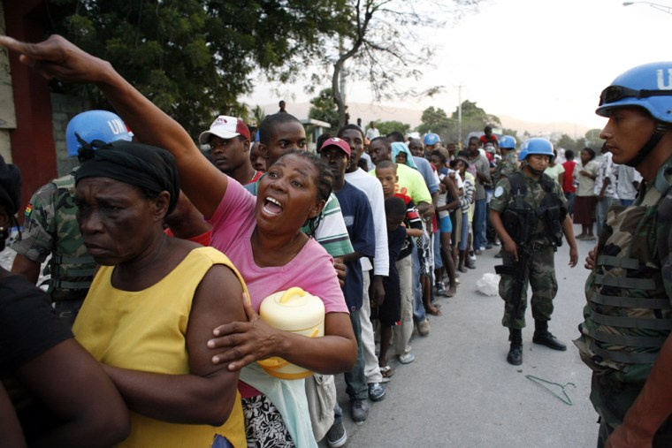 Image: Haitians line up for food distributed by U.N. forces