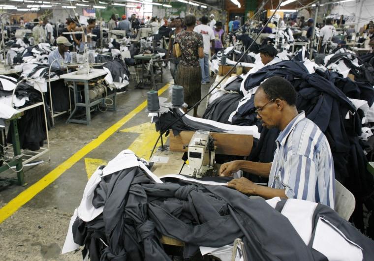 Image: Haitians work inside a clothes factory