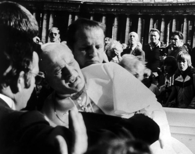 Pope John Paul II grimaces after being shot by a would-be assassin on May 13, 1981.