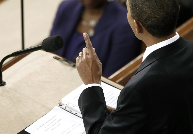 Image: U.S. President Barack Obama makes a point during his first State of the Union Address on Capitol Hill in Washington