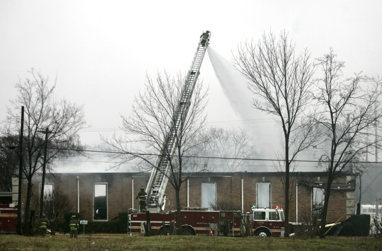 Image: Firefighters put out a fire at the Russell Memorial United Methodist Church
