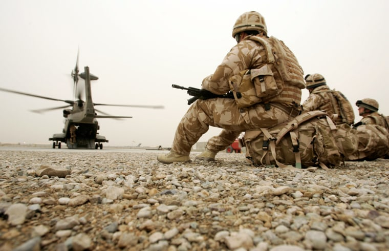 Image: British soldiers wait to be transported to a base in the provincial capital Lashkar Gar in Camp Bastion, Helmand