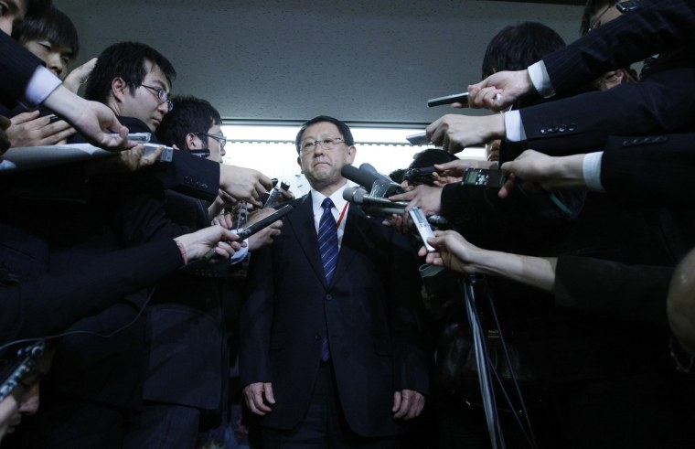 Image: Toyota Motor Corp President Akio Toyoda is surrounded by reporters after meeting with Transport Minister Seiji Maehara in Tokyo