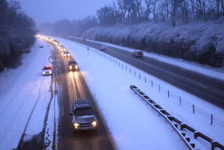 Image: snow backs up traffic