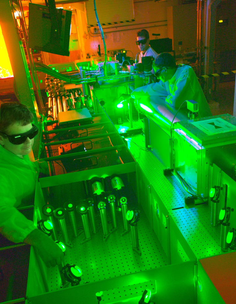 In this 2010 photo, Berkeley Lab researchers work on a 40-terawatt laser that could help blaze a trail for a new breed of particle accelerator.